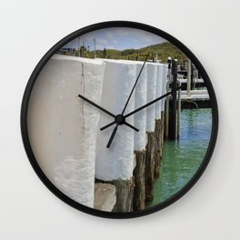 Gleaming white harbor bollards Wall Clock