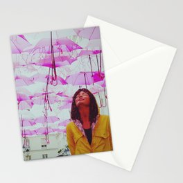Petrichor   Sculpture of a girl in a yellow raincoat feeling the smell of the rain   Pink Umbrellas  Stationery Cards