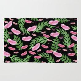 flying leaves in pink Rug