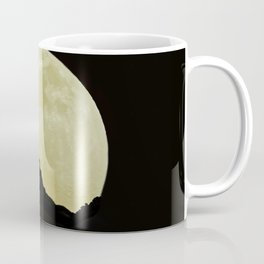 moon in the black sky Coffee Mug