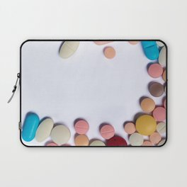 Numerous colorful pills on white background. Laptop Sleeve
