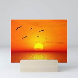 Beautiful sky on sunset or sunrise with flying birds to the sun, natural orange vivid sunset cloudscape sky background Mini Art Print