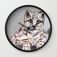 snow leopard Wall Clocks featuring Snow Leopard by RakMeowww
