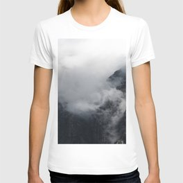 White clouds over the dark rocky mountains T-shirt