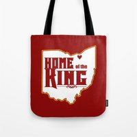 lebron Tote Bags featuring Home of the King (Red) by Denise Zavagno