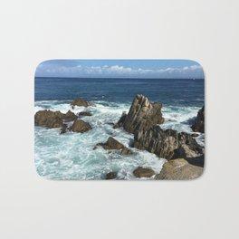 Waves crashing on rocks in Monterey Bay Bath Mat