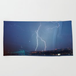 They want rain without thunder and lightning. Beach Towel