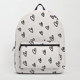 Heart print on beige background. Backpack