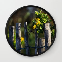 Yellow flower and wood fence Wall Clock
