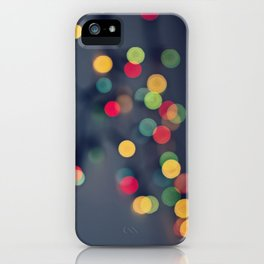 Blurred background with multicolored lights of garland iPhone Case