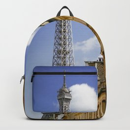 Eiffel Tower seen from the streets of Paris, France. Backpack
