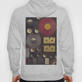 Music. Vintage wall with vinyl records and audio cassettes hung. Hoody