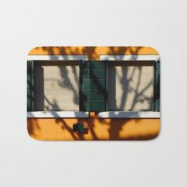 Burano details, windows on orange wall Bath Mat