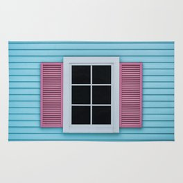 Black window with pink curtains on the blue wooden wall Rug
