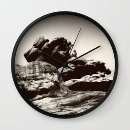 Boy On Rocks Wall Clock