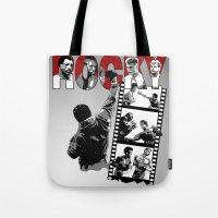 saga Tote Bags featuring Rocky Saga by The Black Lodge
