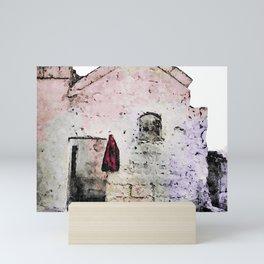 Sassi di Matera with red jacket Mini Art Print