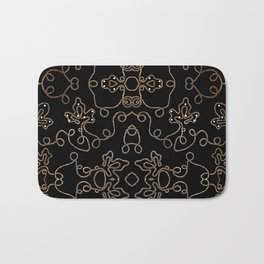 Elegant gold embellishments on black Bath Mat