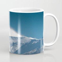 Misty clouds over snowy mountain Snežnik, Slovenia Coffee Mug