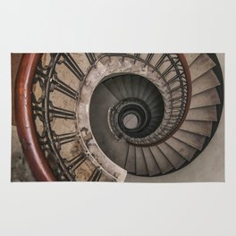 Spiral staircase in pastel brown tones Rug
