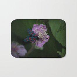 New forest burnet on purple flower Bath Mat