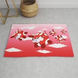 fun red bubble cows in a cloudy sky Rug