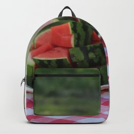 Watermelon and water carafe on garden table Backpack