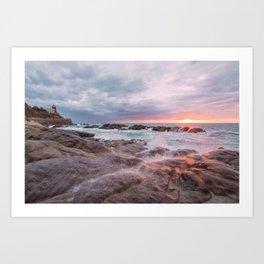 Rocky beach at sunset Art Print