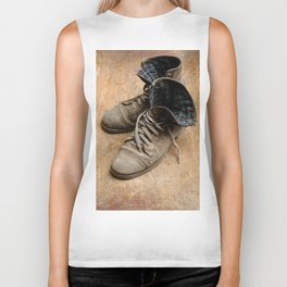 Pair of old leather shoes, worn-out and dusty, on wooden background Biker Tank