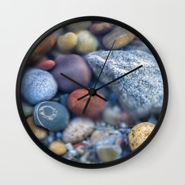 Colorful pebbles covered by ocean water Wall Clock