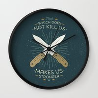 nietzsche Wall Clocks featuring That which does not kill us makes us stronger by Beardy Graphics