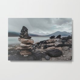 Cairn stack of rocks at Laguna Blanca on a stormy day in Bolivia Metal Print