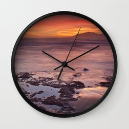 Reflections on the sand Wall Clock
