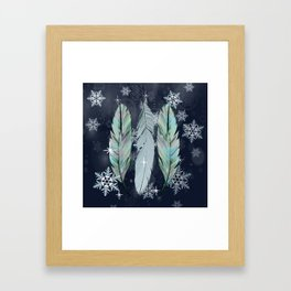 Feathers in the Winter Sky with Snowflakes Framed Art Print