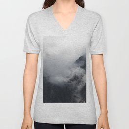 White clouds over the dark rocky mountains Unisex V-Neck