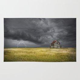 Thunderstorm on the Prairie with abandoned farmhouse Rug