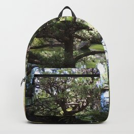 Peaceful Pond in Japanese Garden with Trees and a Bridge Backpack