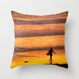 Surfer walking along beach at sunset Throw Pillow