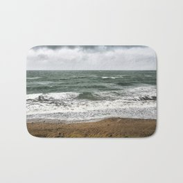 Land and sea under stormy clouds Bath Mat