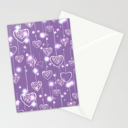 Bright openwork hearts on a lilac background. Stationery Cards