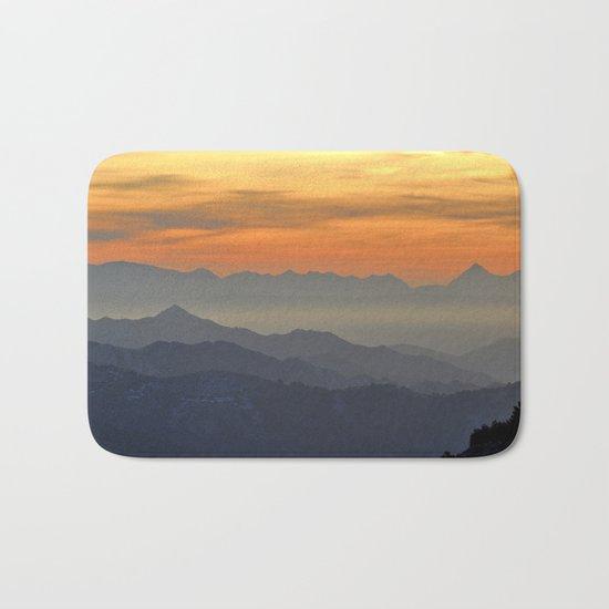 Mountains. Foggy sunset Bath Mat