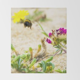 the flight of bumble bee on the bunes Throw Blanket