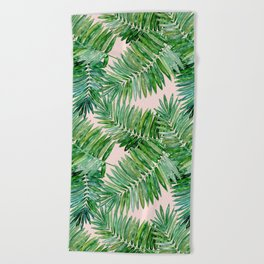 Green palm leaves on a light pink background. Beach Towel