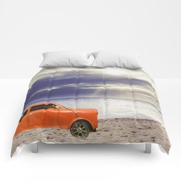 orange classic car on the sandy beach with beautiful sky and beach background Comforters