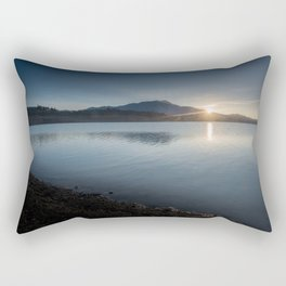 View of the sun rising over the mountaintop from across the lake Rectangular Pillow
