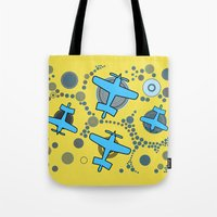 airplanes Tote Bags featuring blue airplanes by Isabella Asratyan