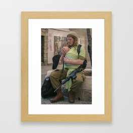 A Soldier & His Baby Framed Art Print