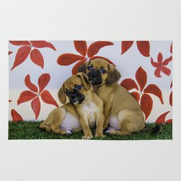 Two Puggle Puppies Snuggling in front of a Background with Hand-painted Red Flowers Rug