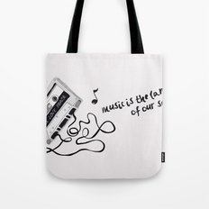 music is the language of our soul. Tote Bag