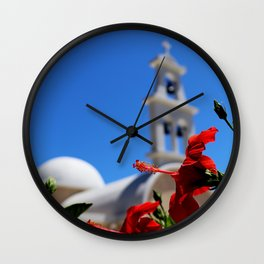 Red hibiscus in front of a greek orthodox church Wall Clock